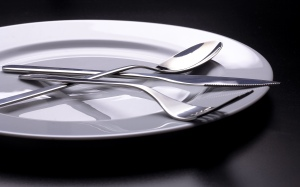 Cutlery on a plate with soft light, on sale for stock photography sites.